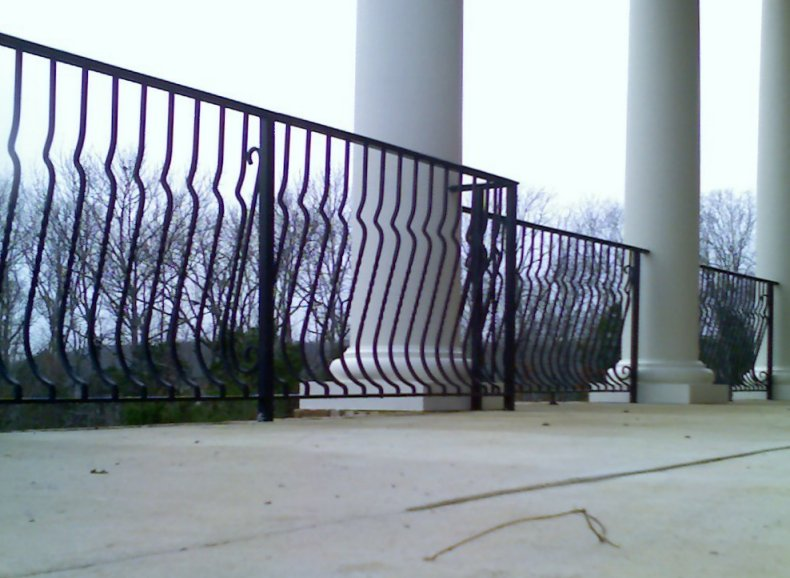 wrought iron railing with forged belly pickets